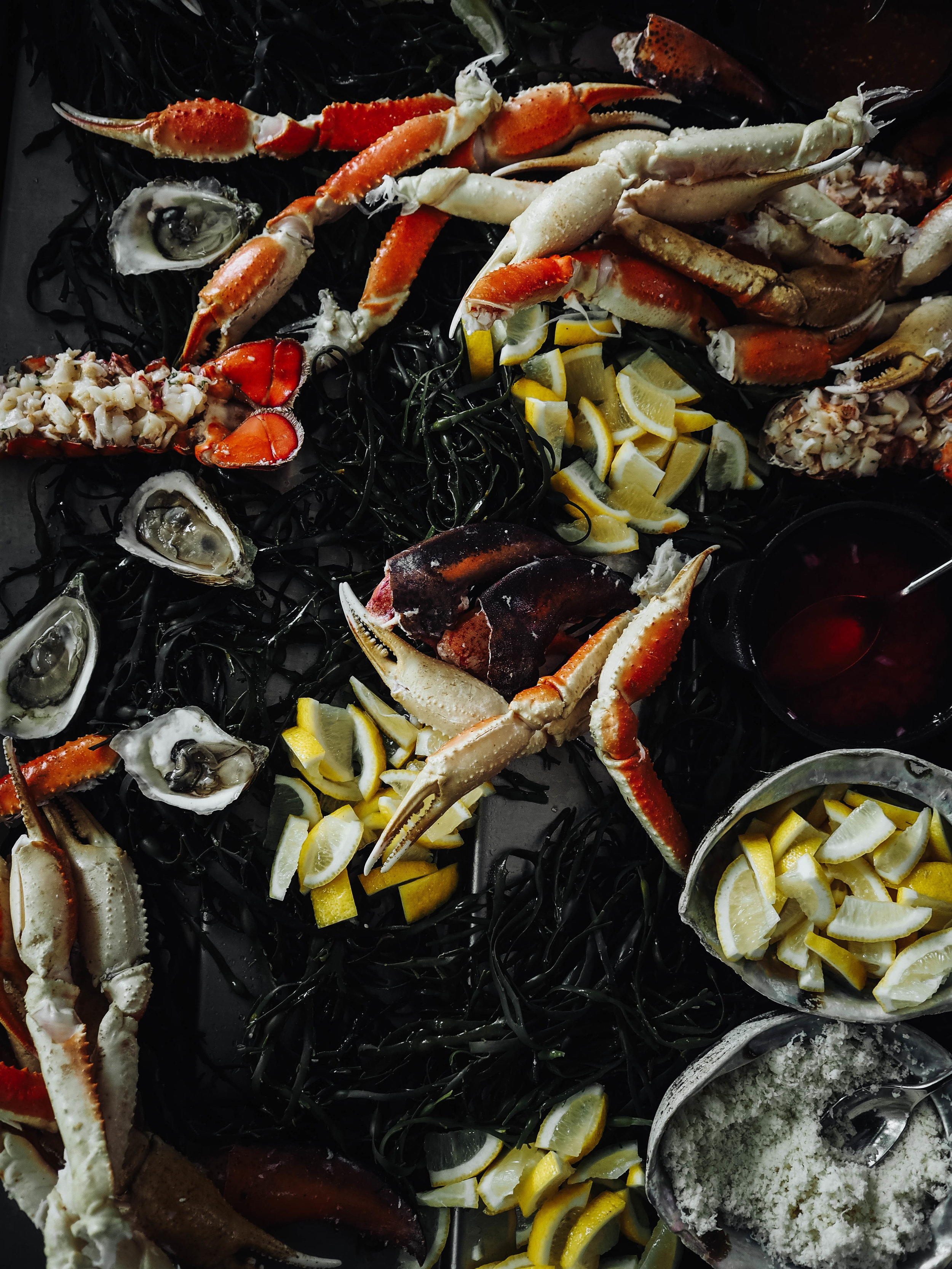 Fresh seafood station featuring lobster tails, crab legs and oysters.
