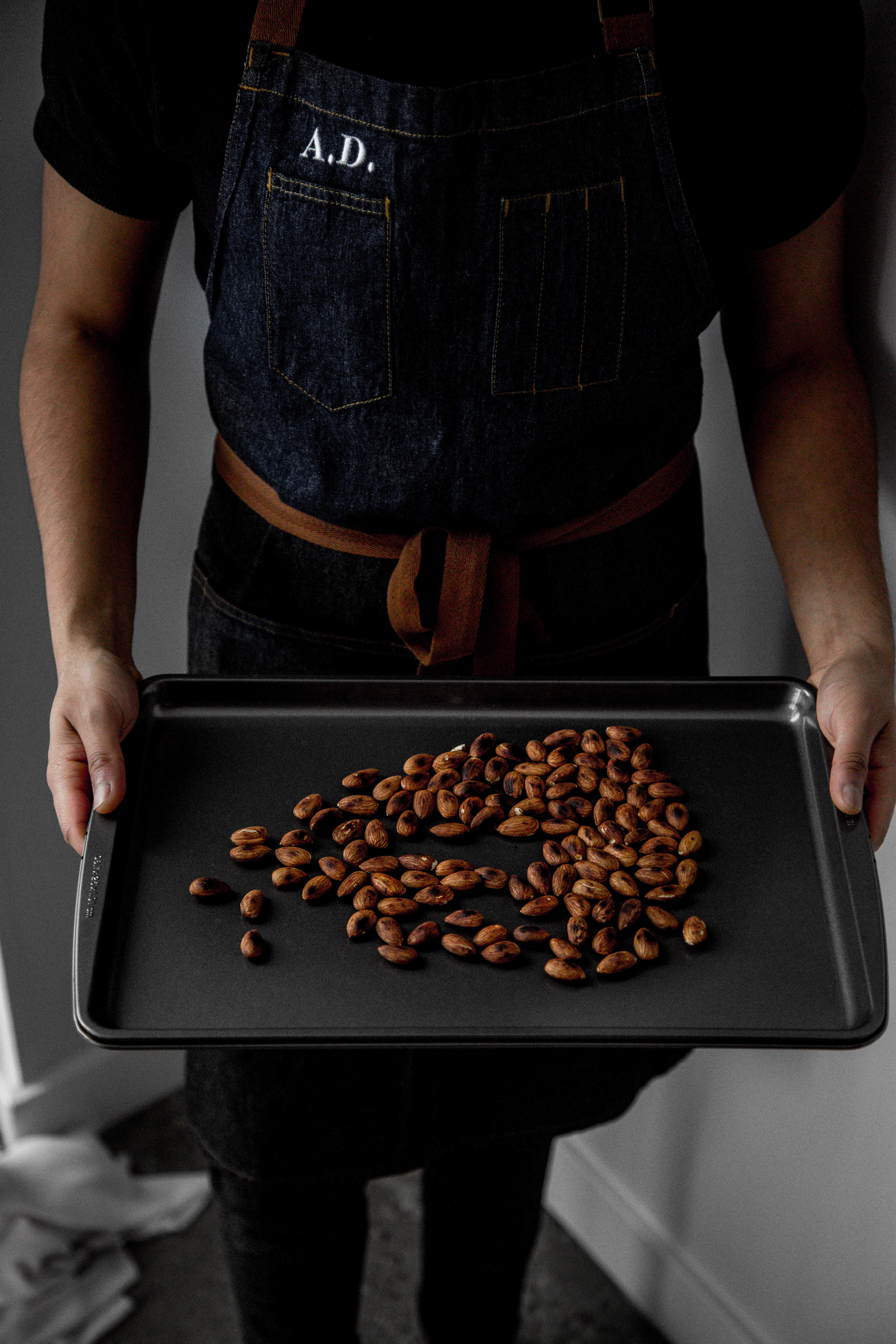 step one. - toast almonds in a dry pan. place on baking tray and allow it to cool.