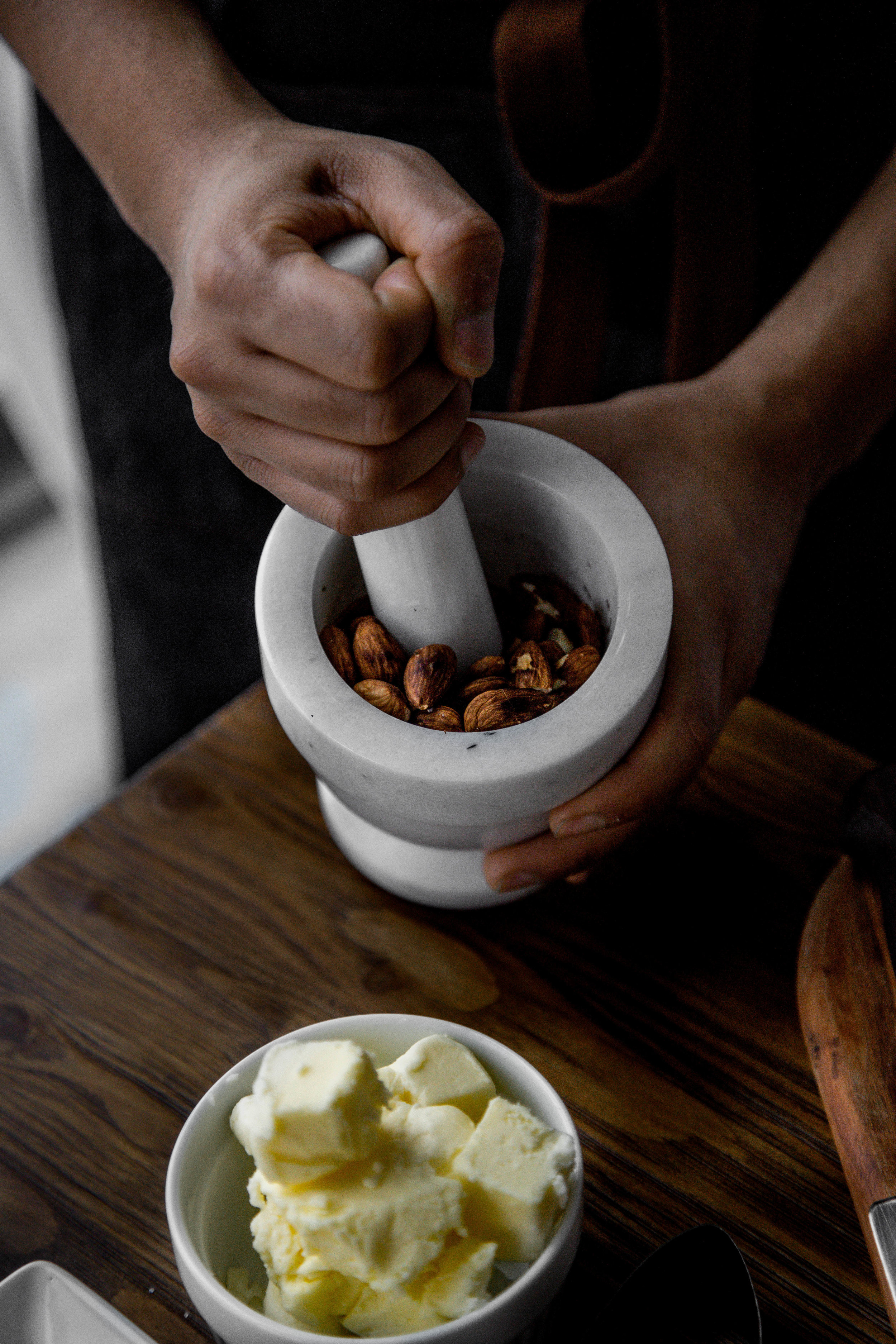 step two. - once almonds are cooled, crush using a mortar and pestle and transfer to a mixing bowl. add brown sugar, butter, salt and cinnamon. mix until a smooth paste is formed. set aside in refrigerator.
