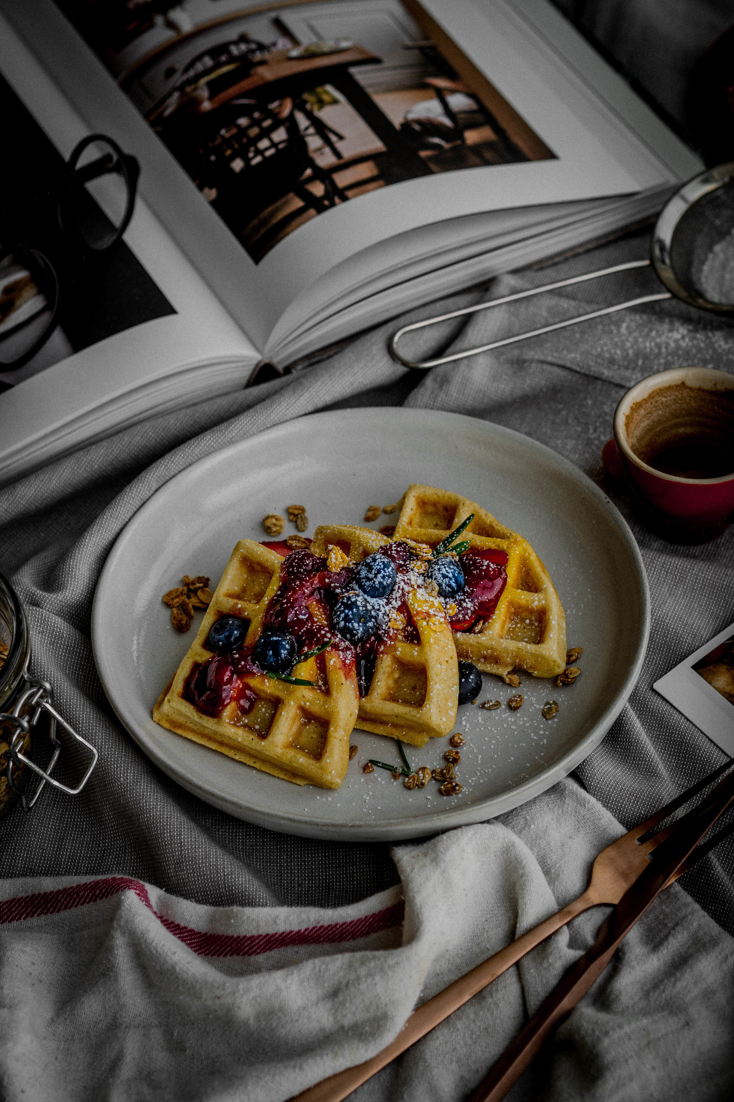 waffle #2: topped with rosemary infused strawberry jam, powdered sugar, blueberries and granola. -