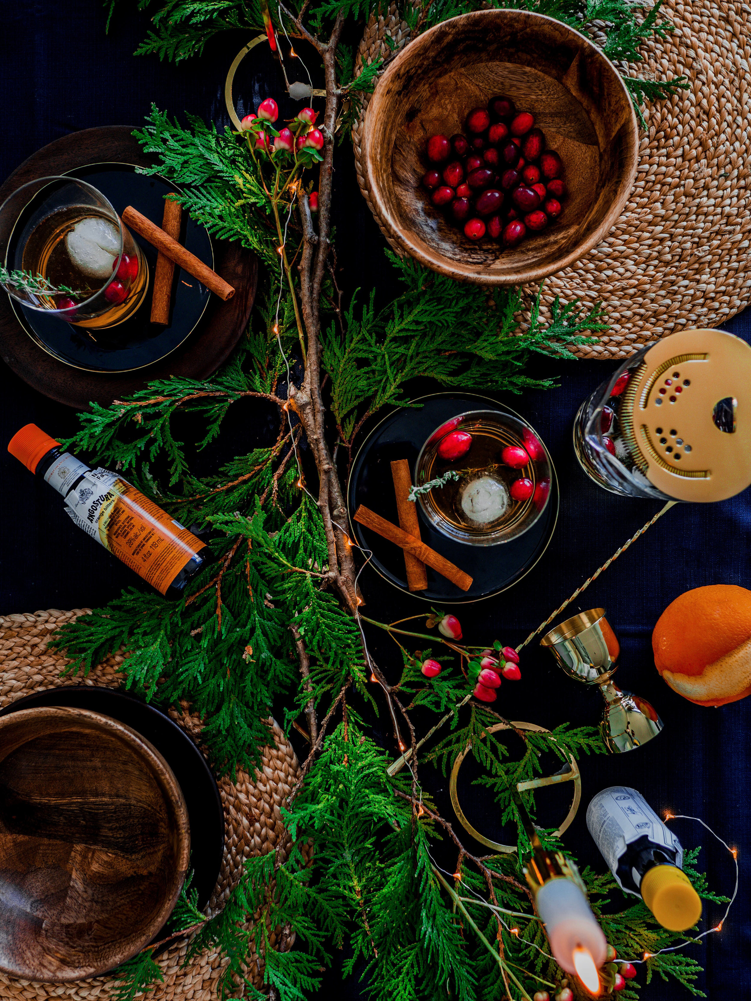 the ingredients. - • 3 oz. your favourite Bourbon or Rye Whiskey• 1 oz. Cranberry Simple Syrup (1 part sugar – I enjoy Demerara or Turbinado, 1 part water and a handful of cranberries. Boil in a saucepan and stir to dissolve)• 3-4 dashes ANGOSTURA orange bitters• Garnishes: Fresh Cranberries, Rosemary or Thyme• Ice