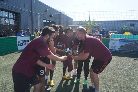 Futsal Society Raising Trophy.JPG