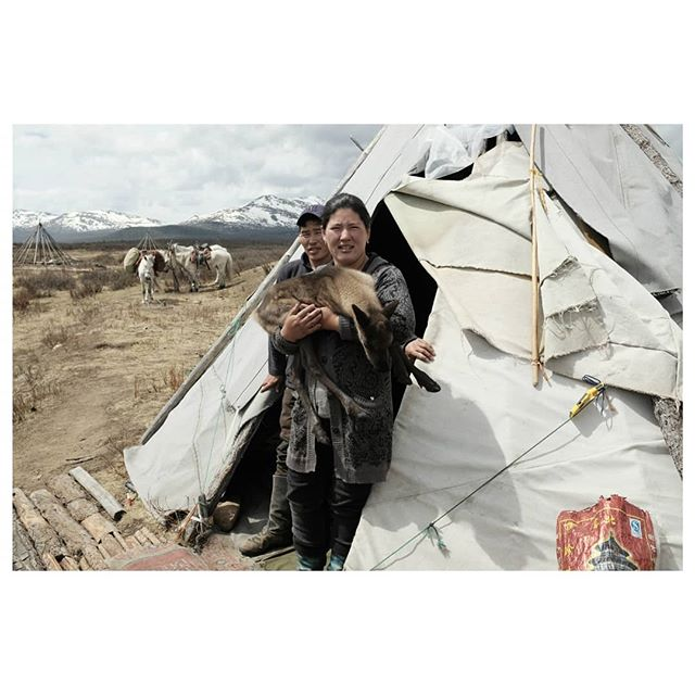 zaya, oltsun and baby jade . oltsun is a tsataan herder raised on the taiga. zaya is a city girl from ulaanbaatar. they fell in love and have built for themselves a beautiful life in the wilderness. in our three days together, zaya and oltsun taught us about the tsataan traditions, their respect for the spirits of the earth, sky, fire, and water, and the hardships and wonders of life on the taiga. we are forever grateful and can't wait to meet you again, our friends . #teepeelife #therealnomads #reindeerherder #tsataan #tuvan #nomads #centralasia #taiga #northernmongolia #mongolia