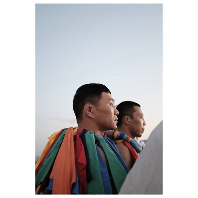 READY - SET - GO ! . mongol chinese wrestlers at the opening ceremony of the 3rd world nomad games in kyrgyzstan. best honeymoon eva ! we have been waiting for this since we stumbled upon a great article by @guardian 2 years ago. a week filled of insane sports with names hard to pronounce, very cool and inspiring folklorique outfits, kasha breakfast and vodka soaked dinners and many beautiful encounters. . #honeymooning #worldnomadgames #worldnomadgames2018 #fujifilm #cholponata #kyrgyzstan
