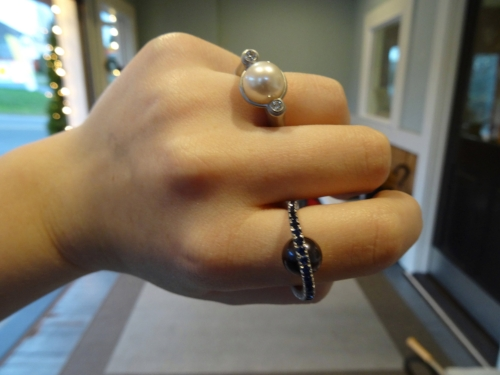 Sterling silver and 14k white gold 10 mm pearl and .13 ct tw diamond ring, size 7. $650 Sterling silver and 14k white gold .70 ct tw blue sapphire and 8.6 mm peacock pearl ring, size 7. $625