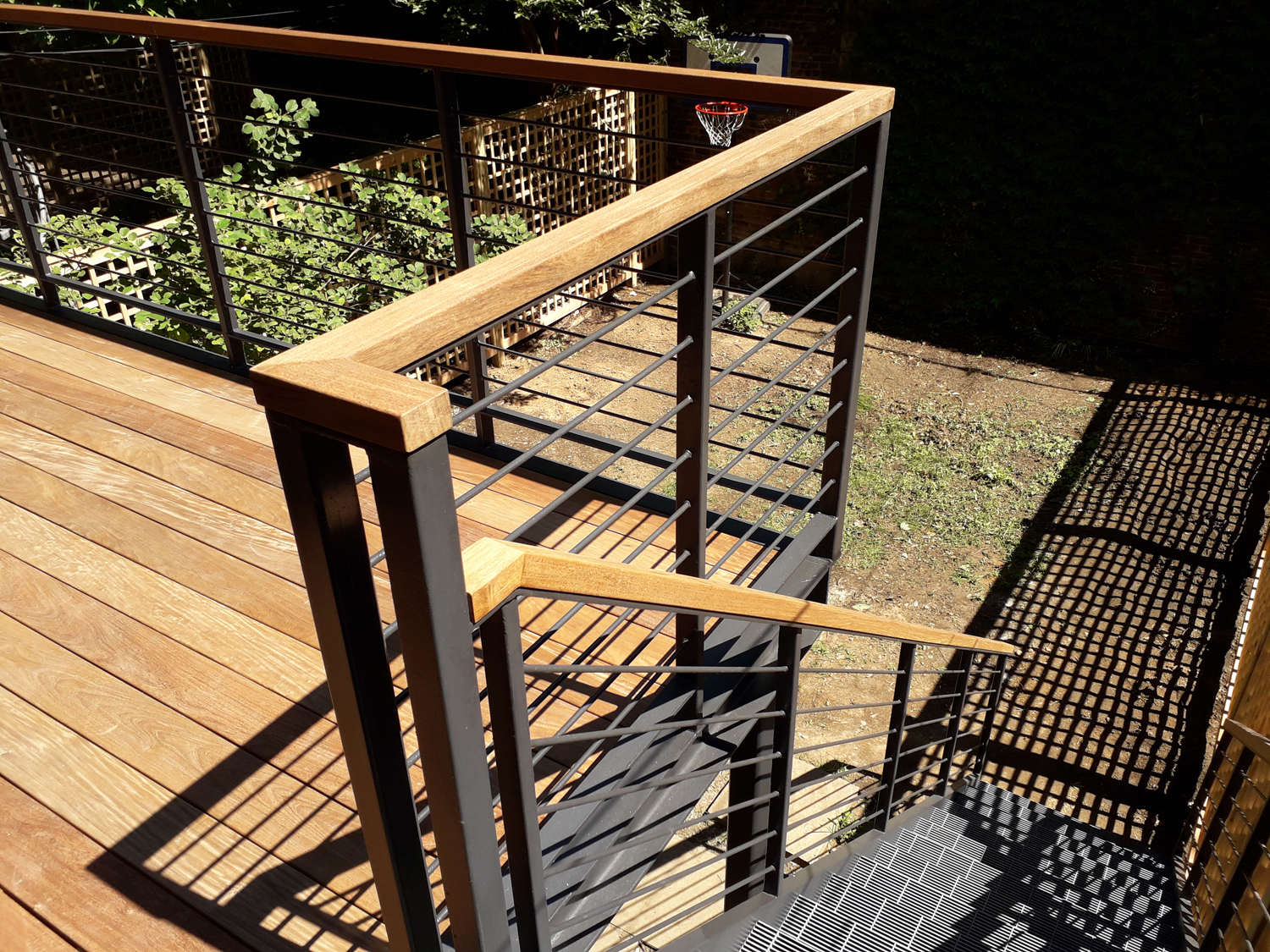 Steel deck with ipe decking and handrail.