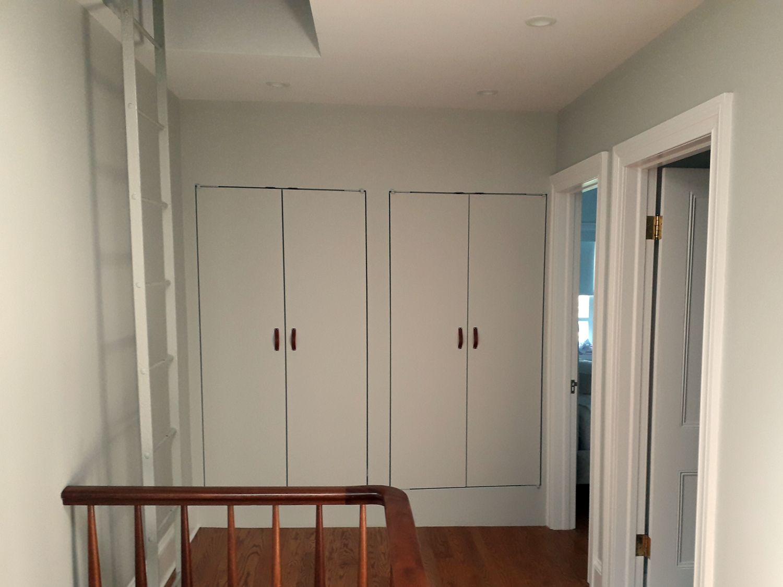 Trimless linen closets at top floor.