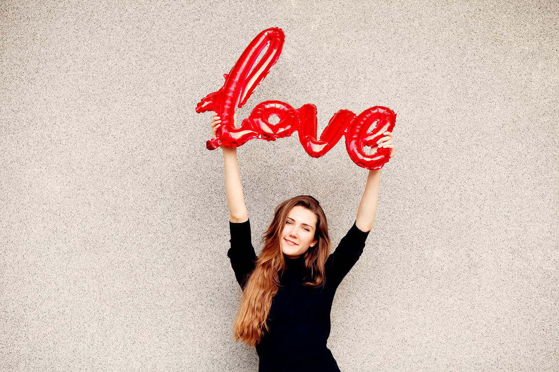 Canva - Woman Holding Love Sign 3.png