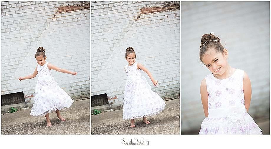Cute flower girl twirling in her dress