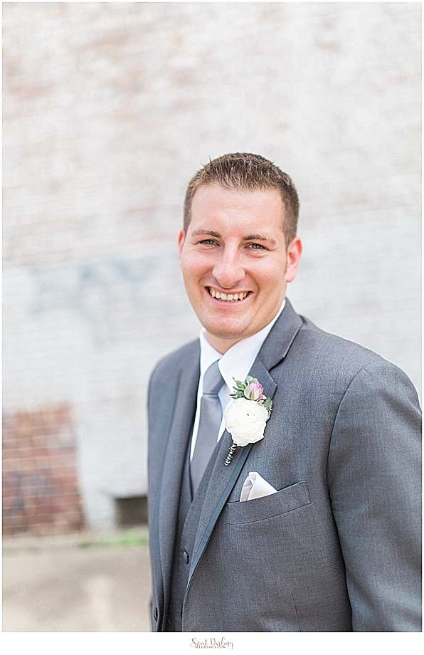 groom wearing boutonniere by Flora Design