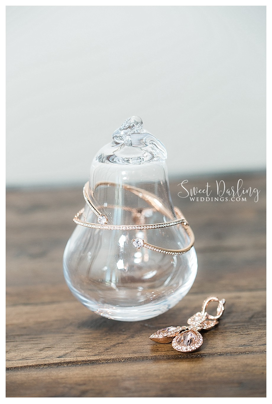 Bride's jewelry on glass pear
