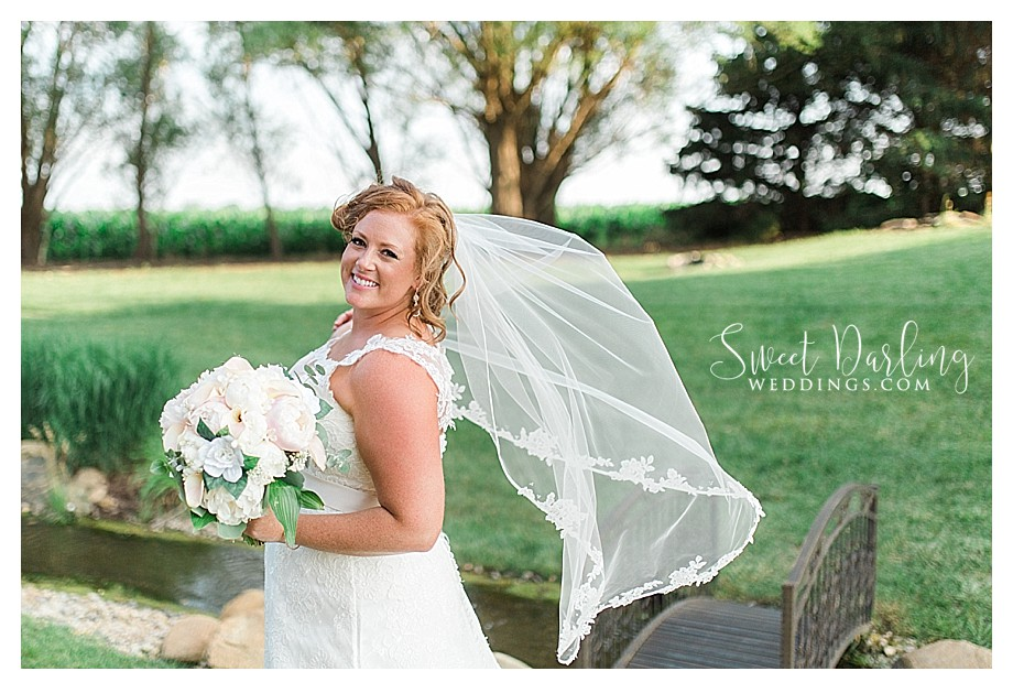 bride wearing a vail that is blowing in the wind