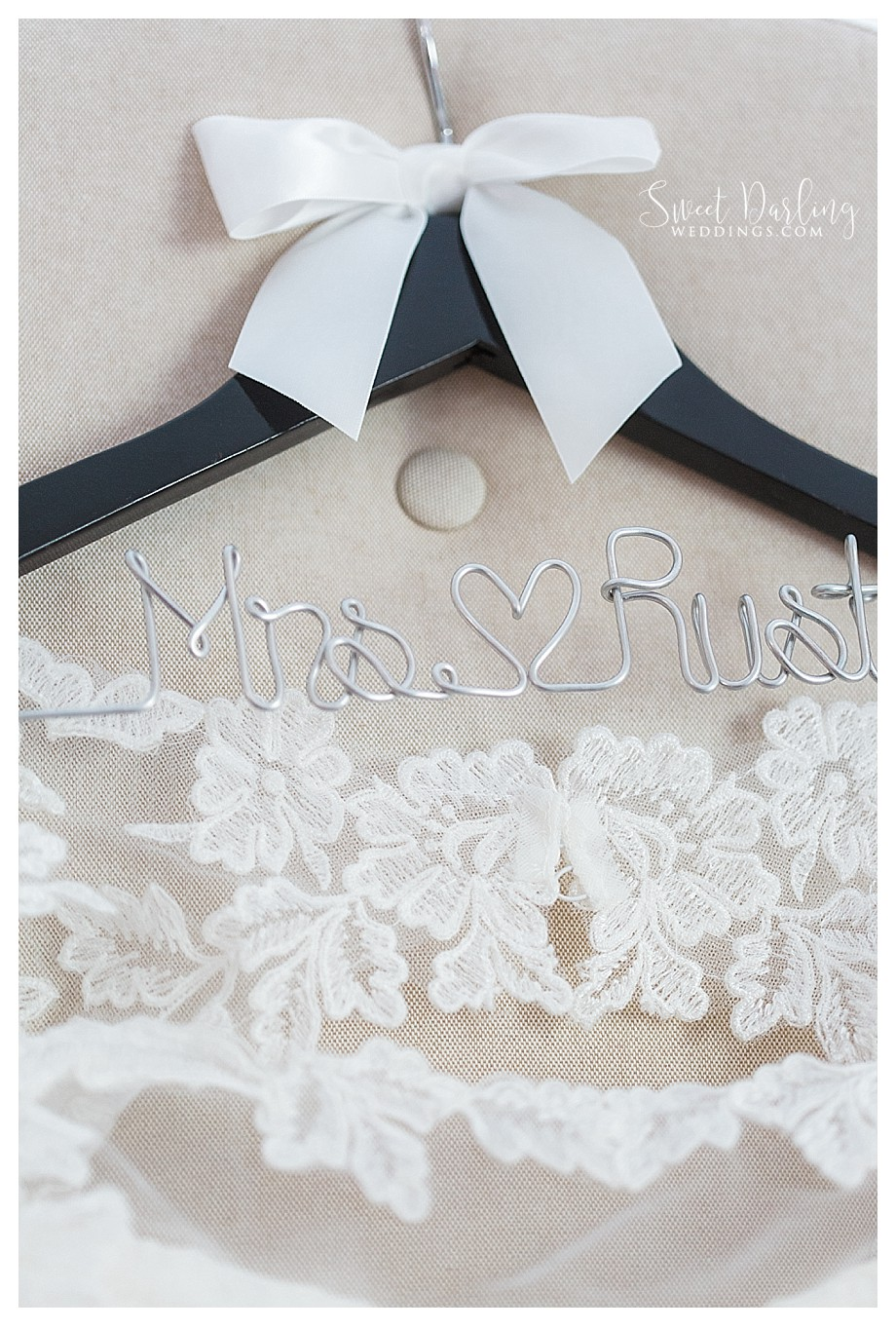 custom wedding wooden hanger holds lace wedding gown