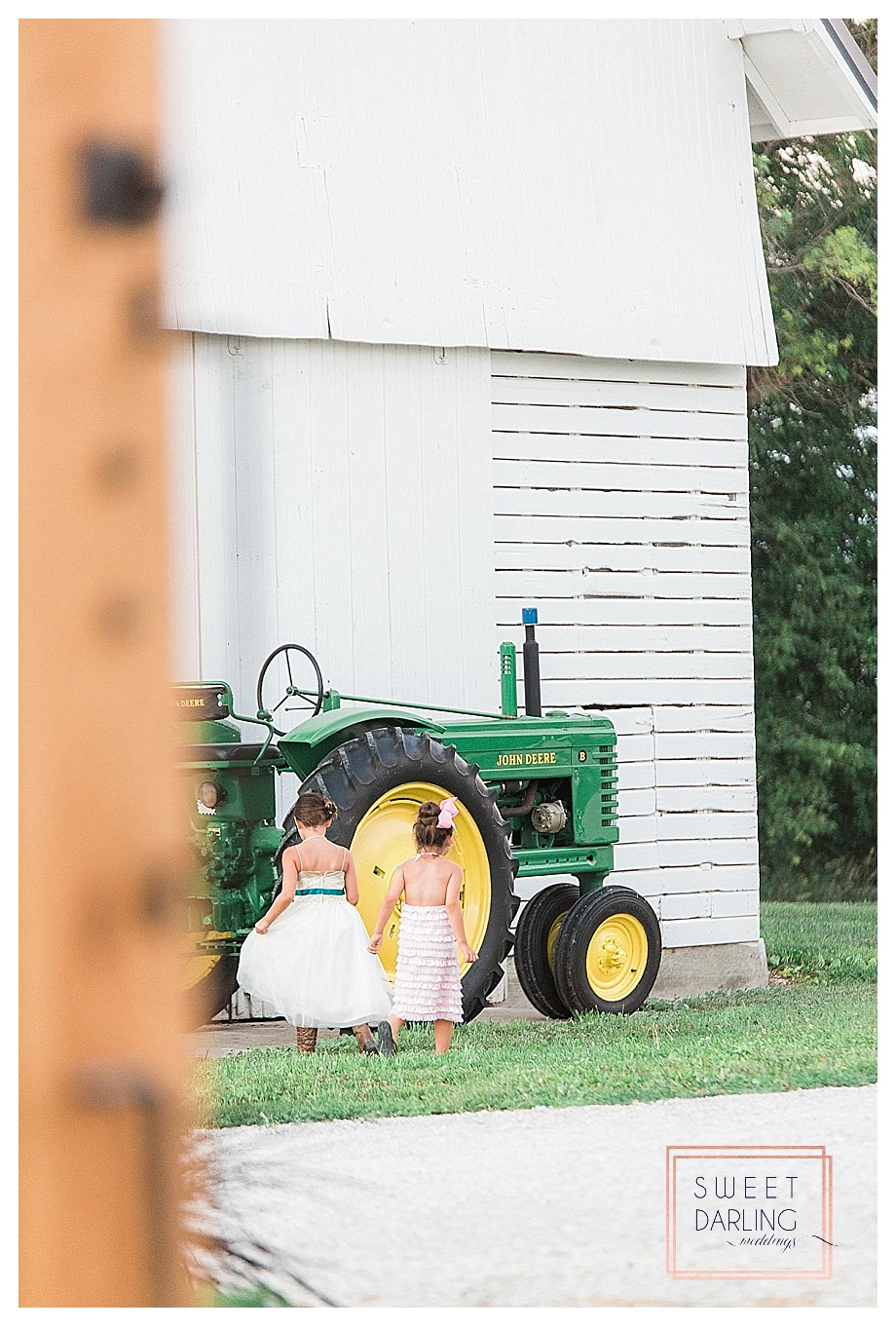 flower girl at wedding with John Deere tractor