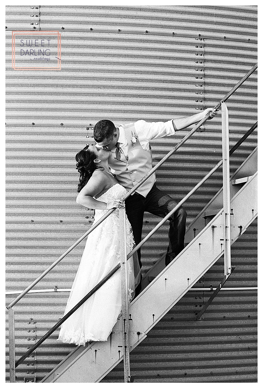 bride and groom on steps of grain bin