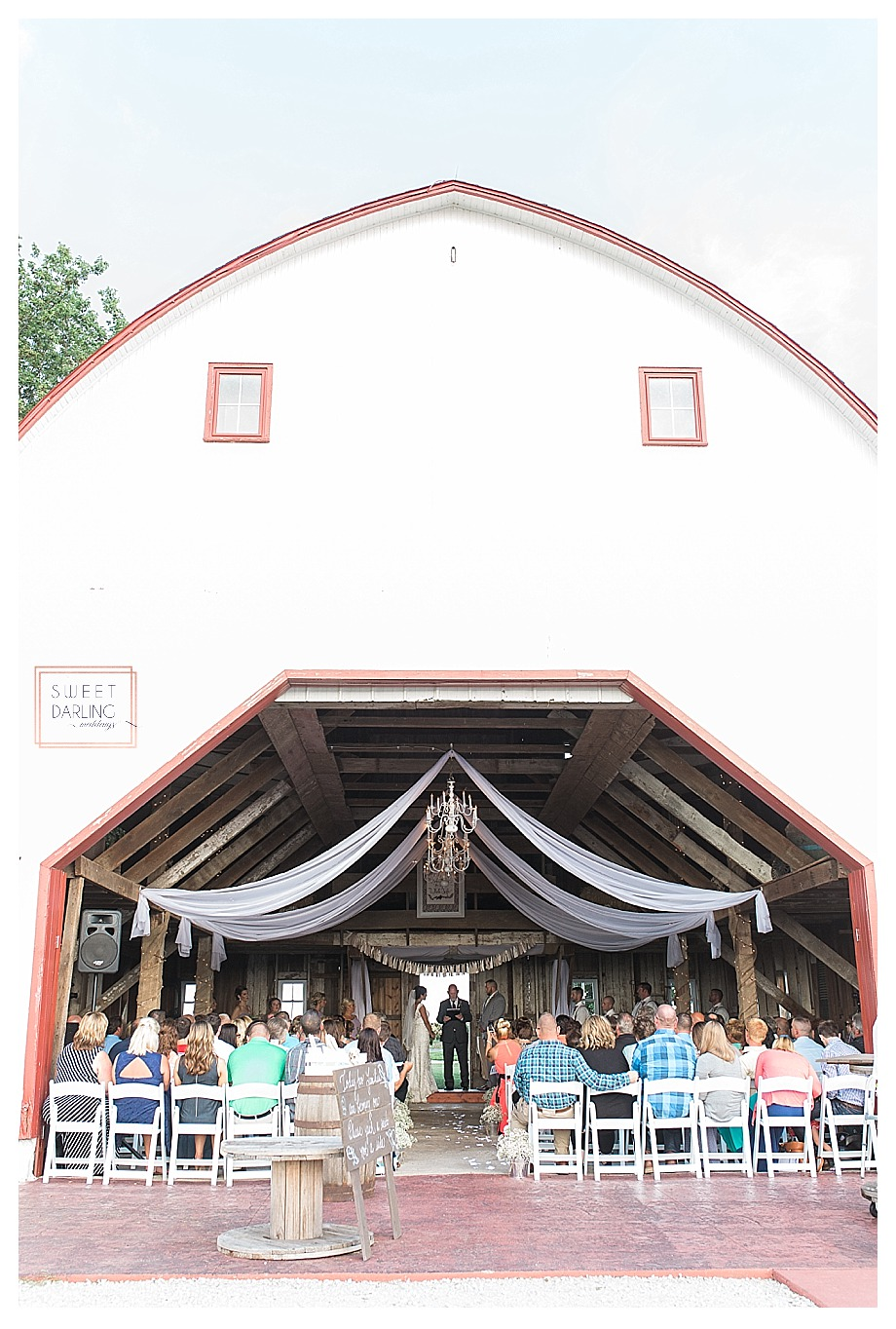 Country wedding inside barn at Hudson Farm