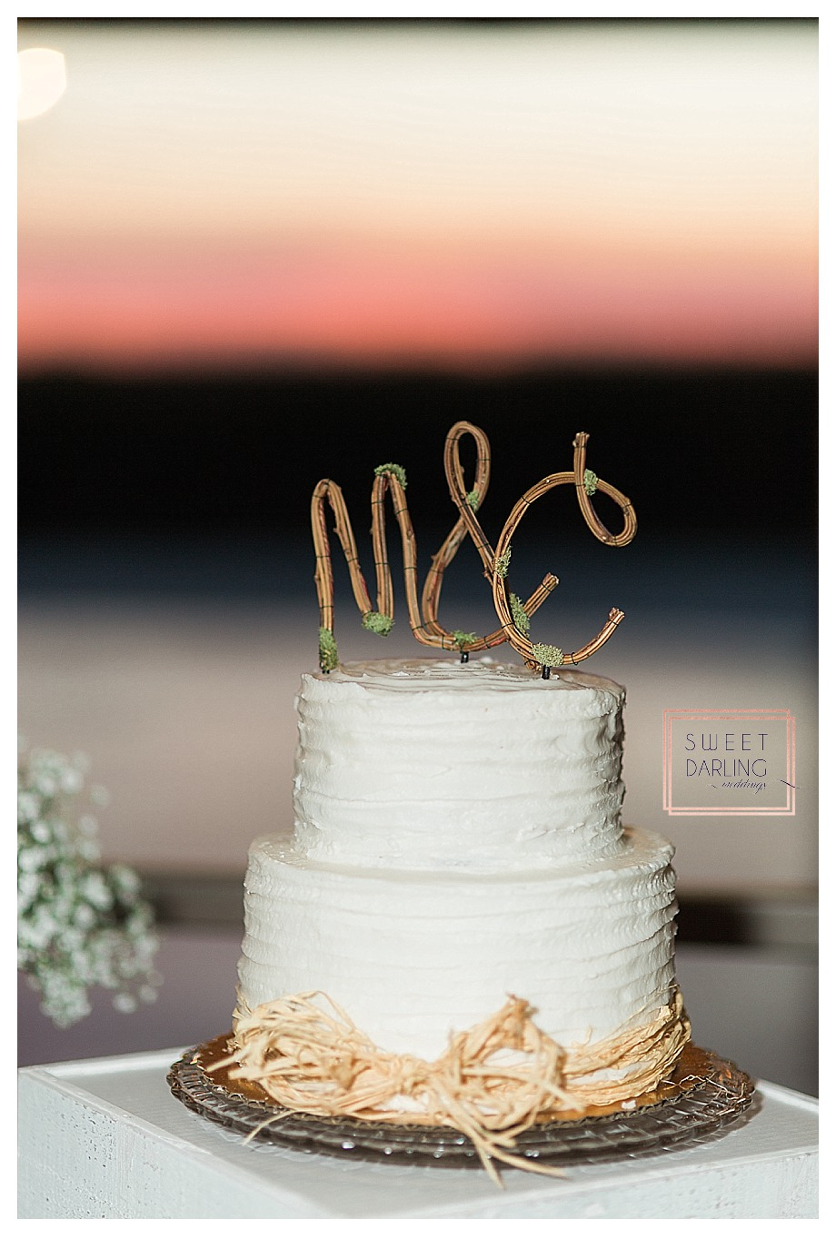 wedding cake with wooden stick iniitials