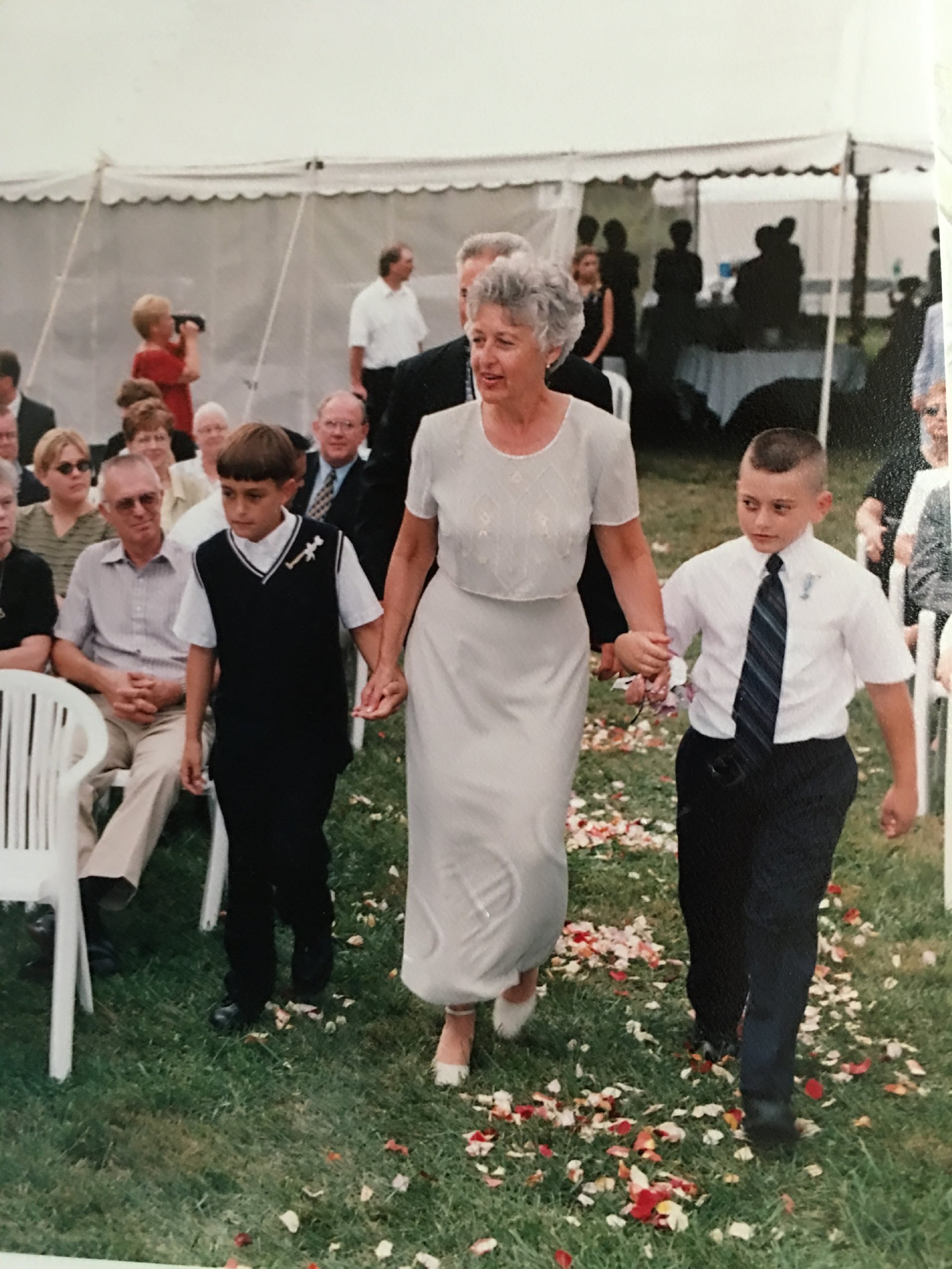 Grandsons walk grandma down the aisle.