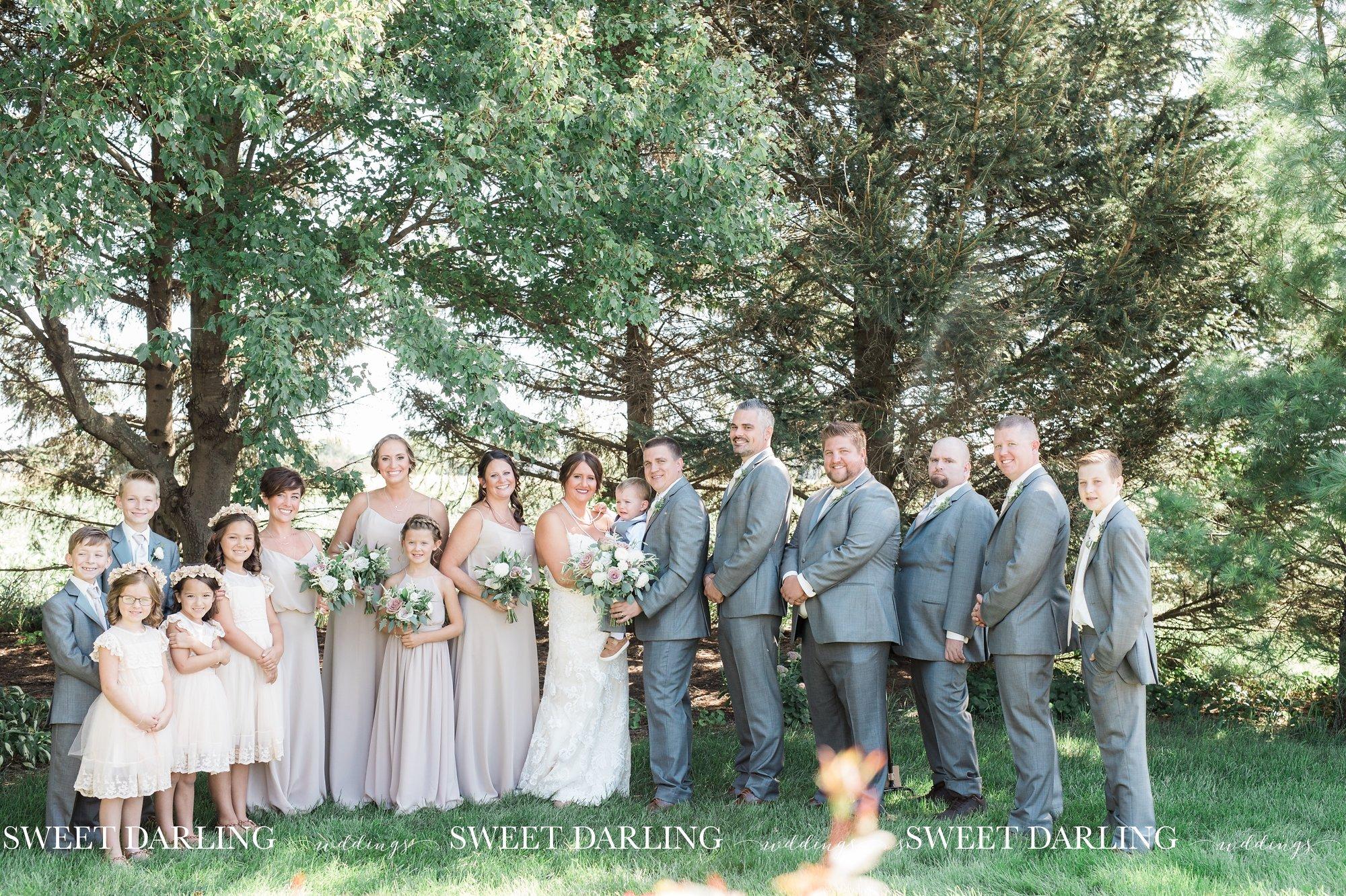 Bridal party at fall pear tree estate wedding