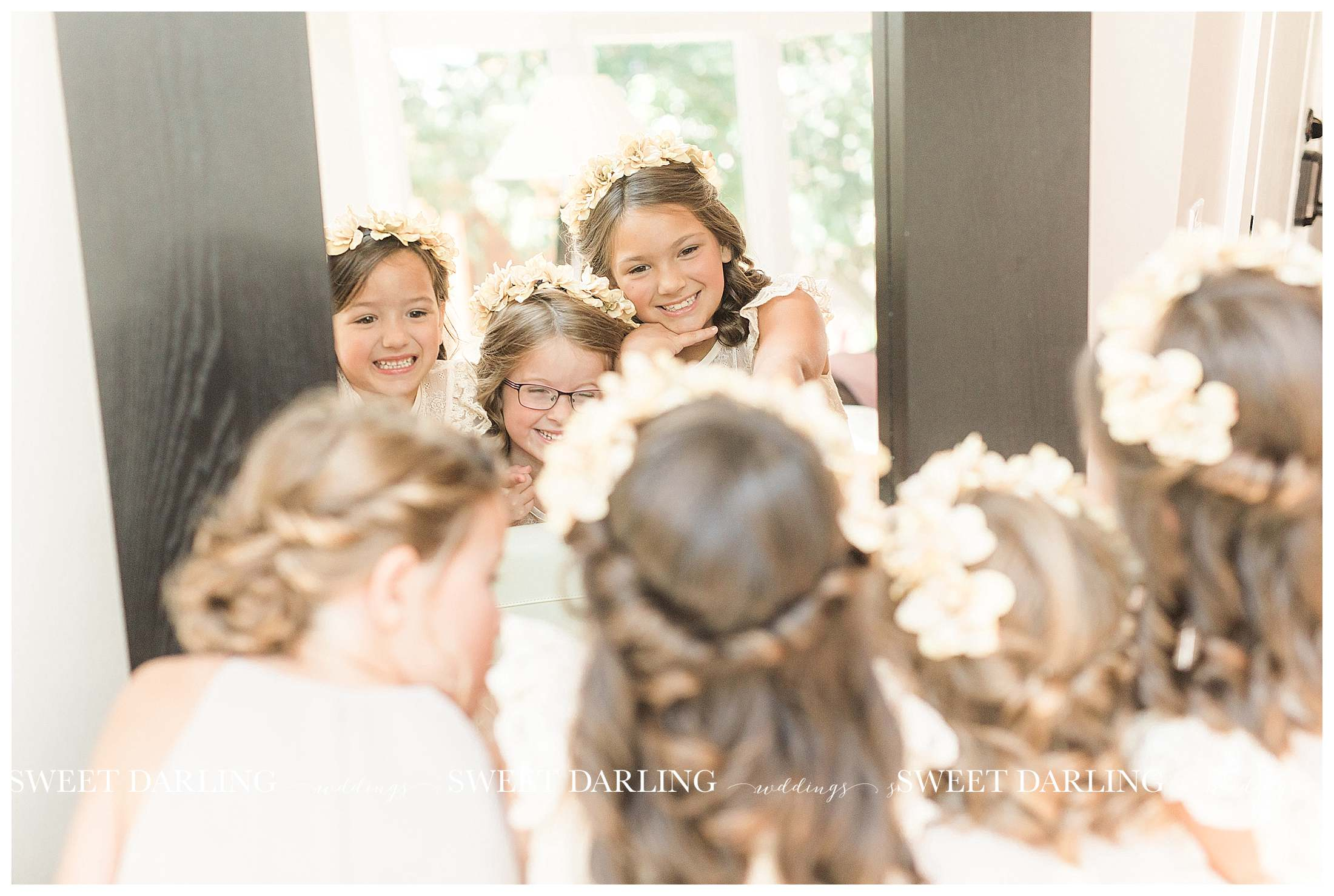 Flower girls looking in mirror in central illinois
