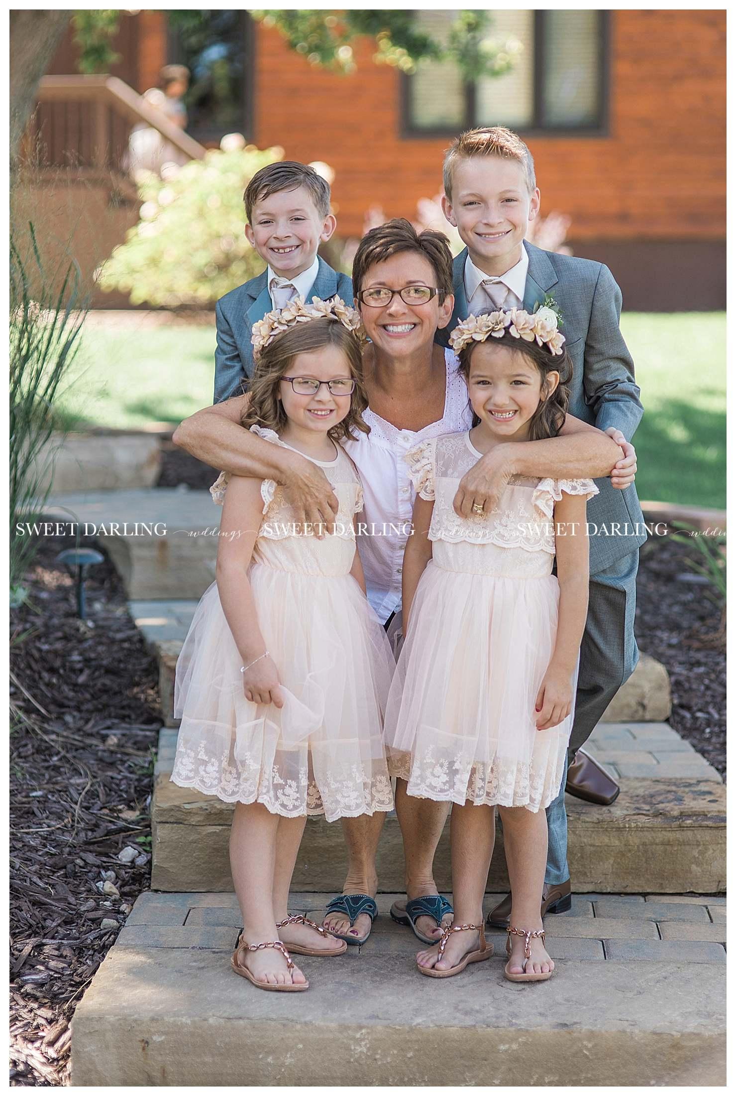 Grandma with grandkids at fall wedding