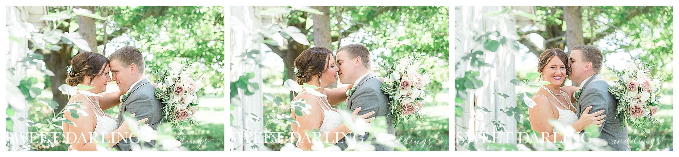 Close-up of bride and groom with trees