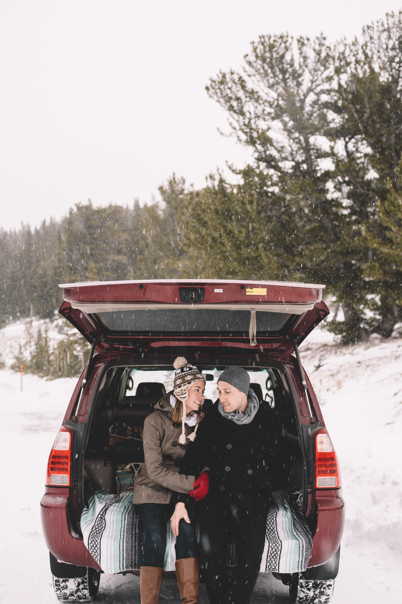 Back of Car Snowing Engagement Colorado
