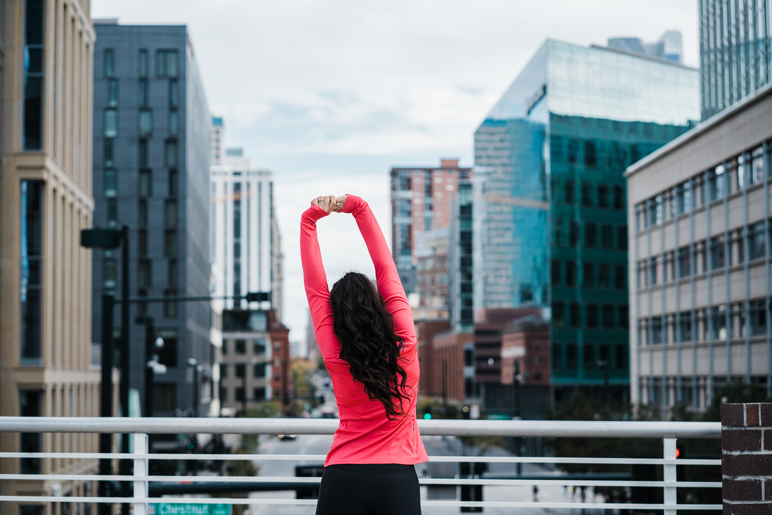 Girl-Stretching-Downtown-Denver.jpg