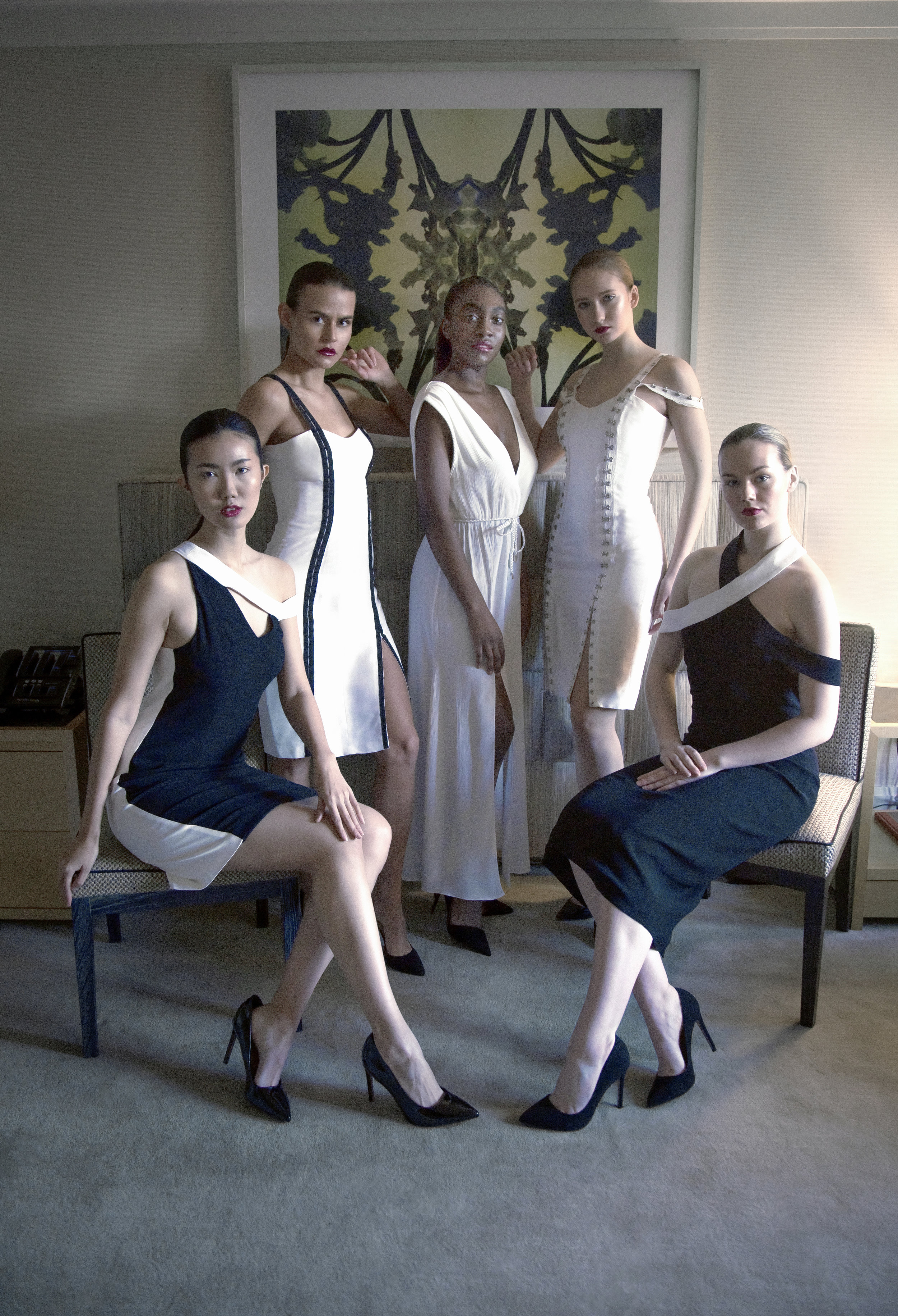 Look 8   (left to right) Asymmetrical off-the-shoulder dress, Fitted bustier dress, Belted maxi dress, Hook & eye trim dress, Criss cross + off the shoulder combo dress