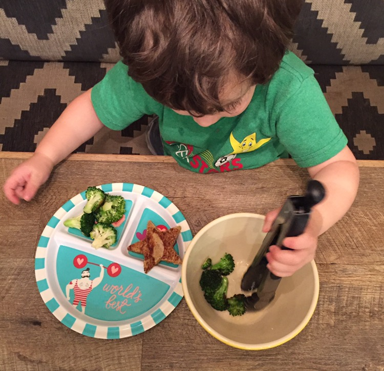 """""""You may go ahead and serve yourself"""" allowed me to continue getting dinner ready and even though the tongs were very intimidating at first, after a little encouragement of """"You don't have to do it perfectly but you do have to try!"""", this guy learned a new fine motor skill!"""