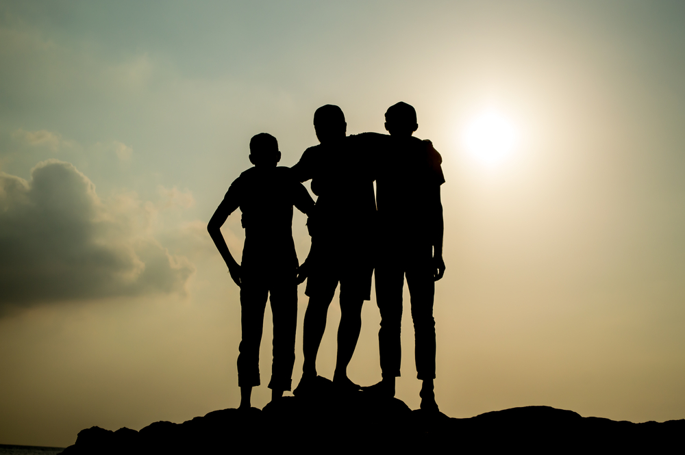 Group Silhouette During Sunset - shutterstock_351979862.jpg