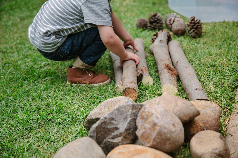gross-motor-development-sticks-outdoor-child-play-environment