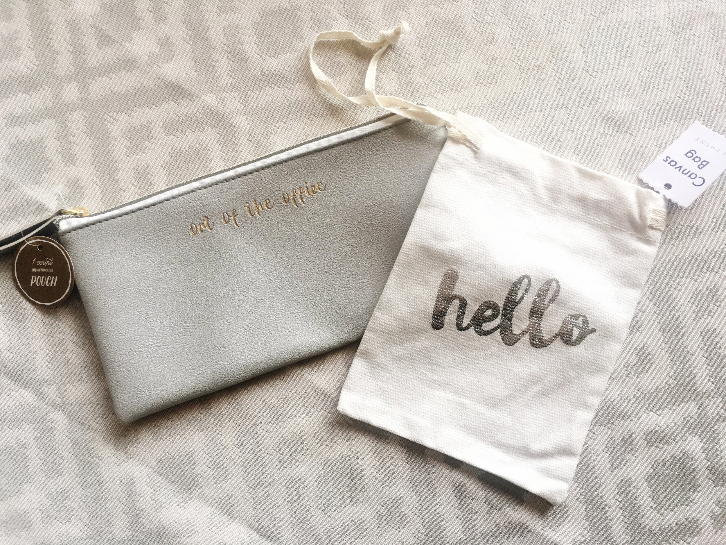 """""""Out of the Office"""" Gold & Grey Zippered Pouch, $3 -- Hello Canvas Drawstring Bag, $1"""