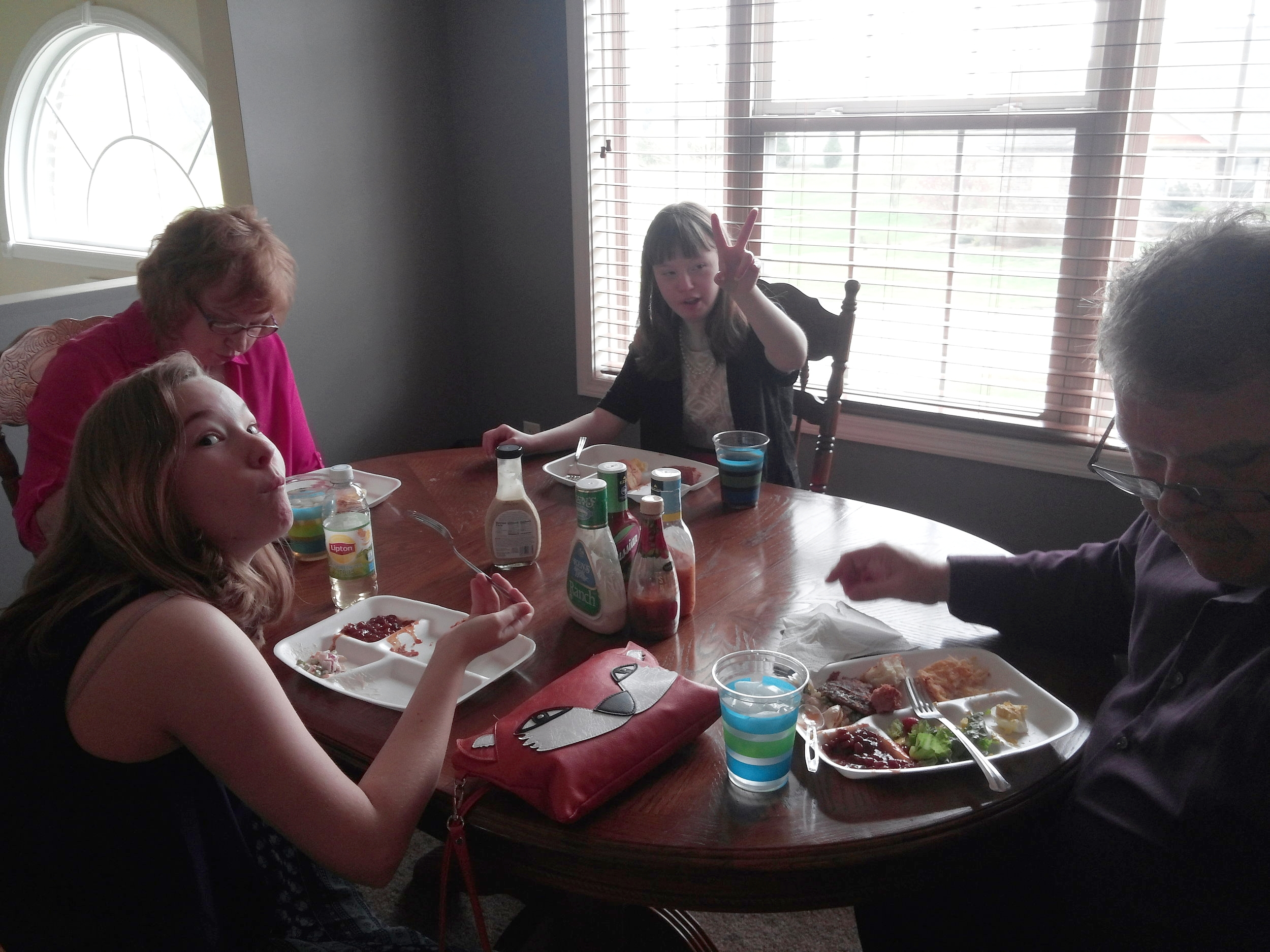 The family chowing down on Easter dinner, 2016