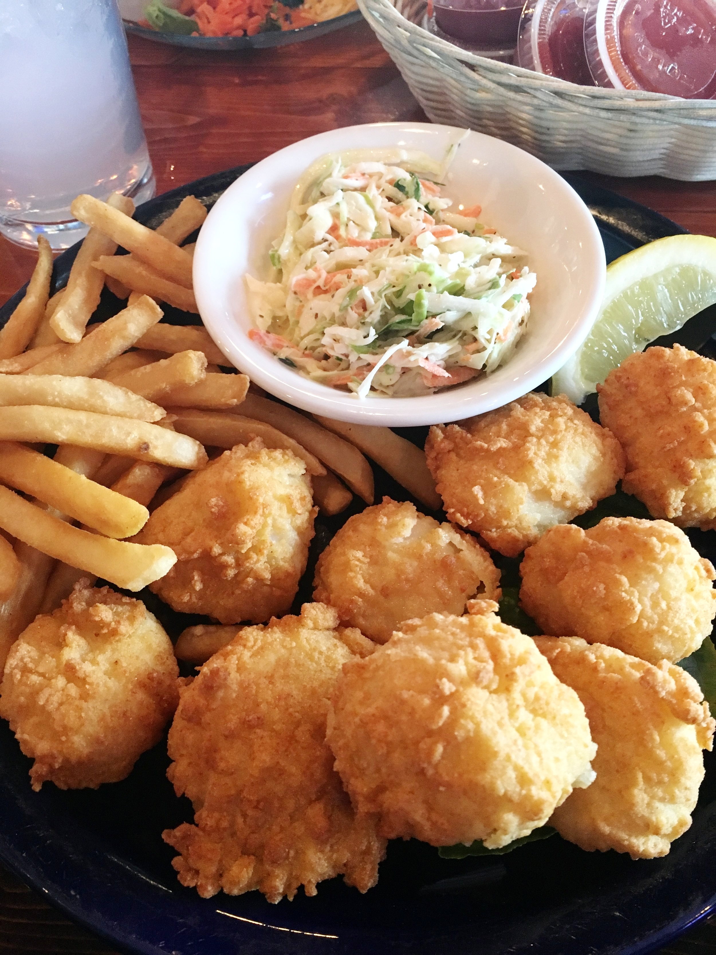 My fried sea scallops, coleslaw, and french fries. The price was around $24.