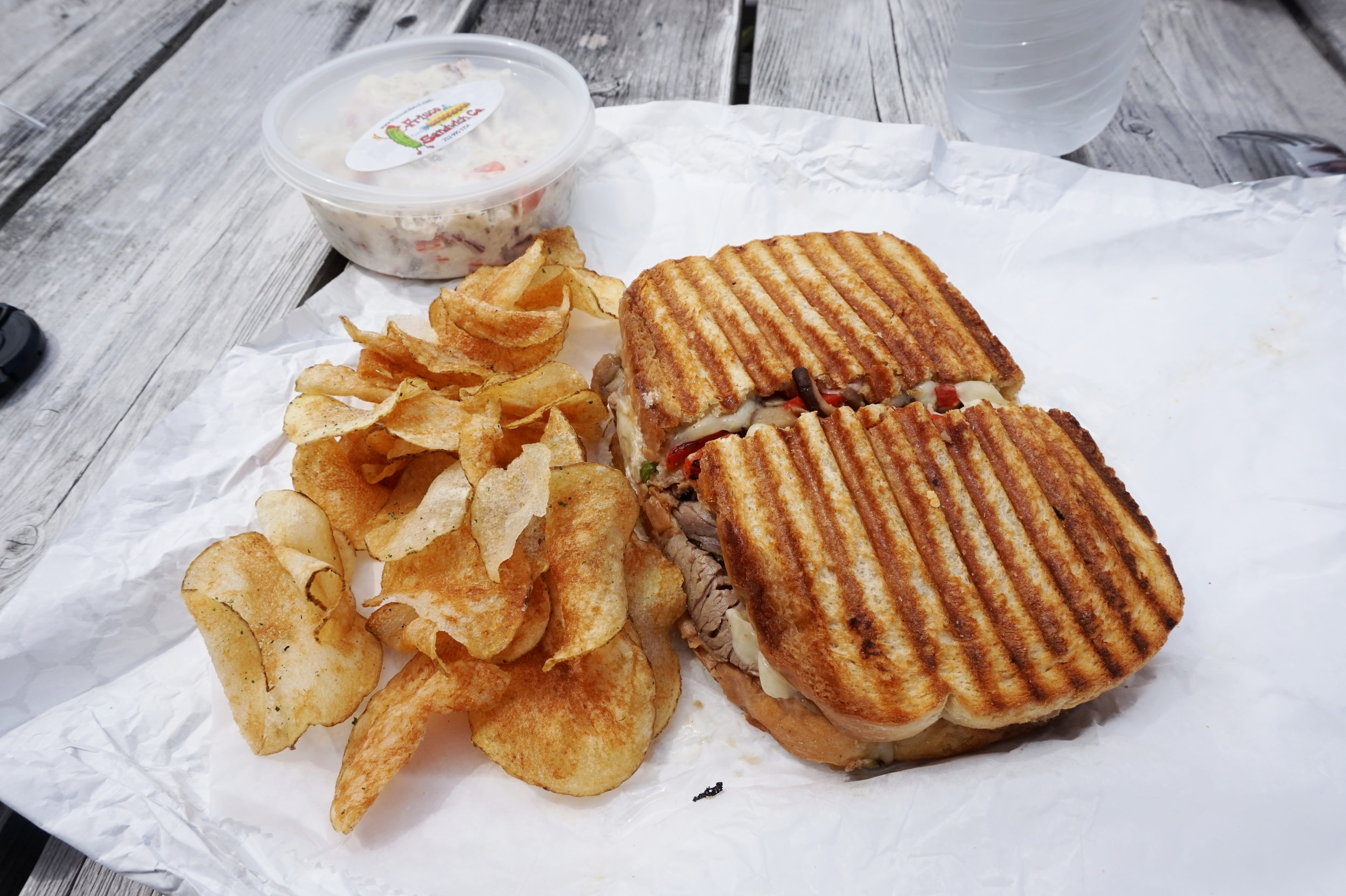 The Roast Beaster panini, with homemade potato chips and potato salad, from Frisco Sandwich Company.