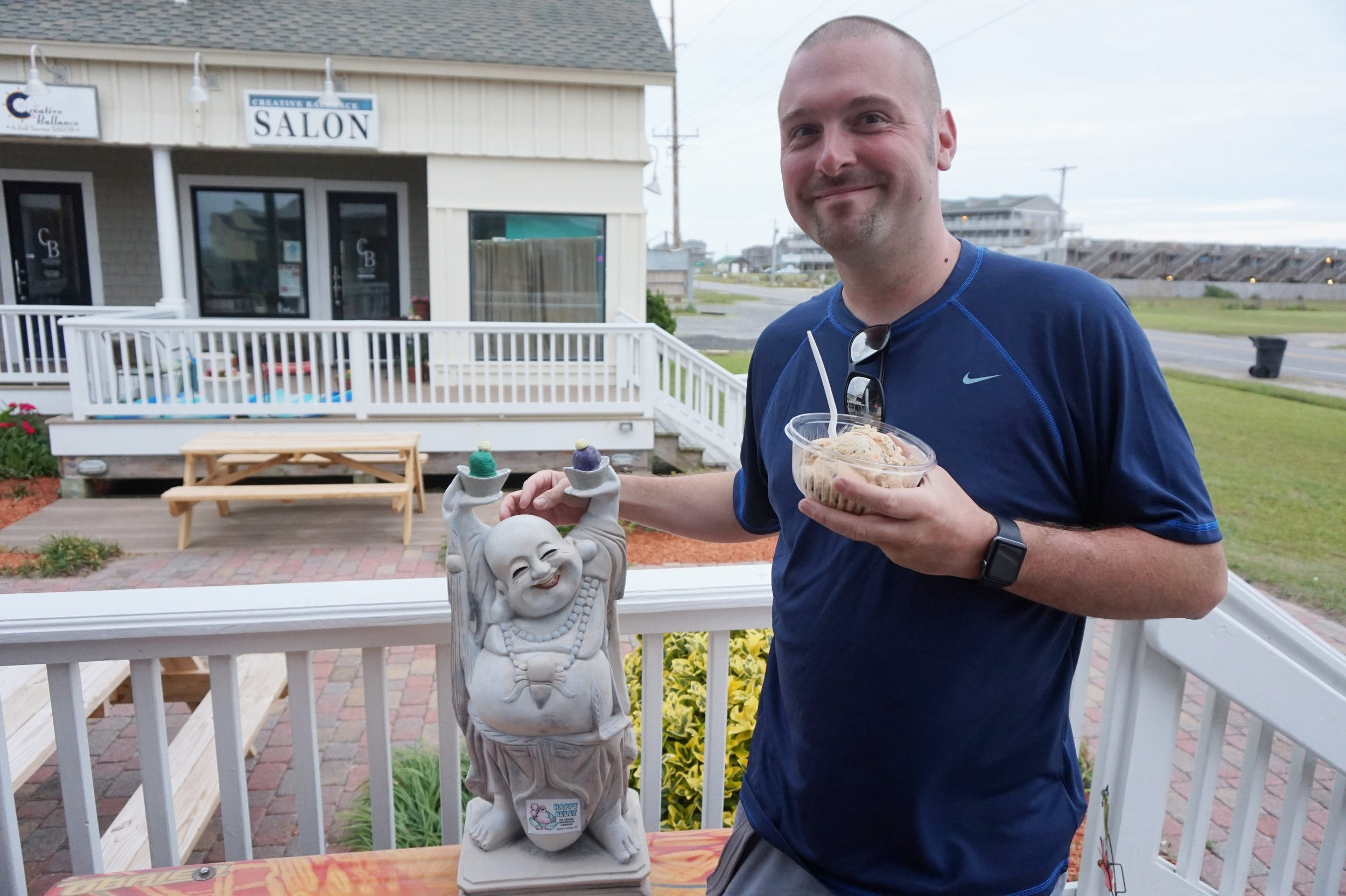 Happy Buddha and a happy husband outside of Happy Belly!