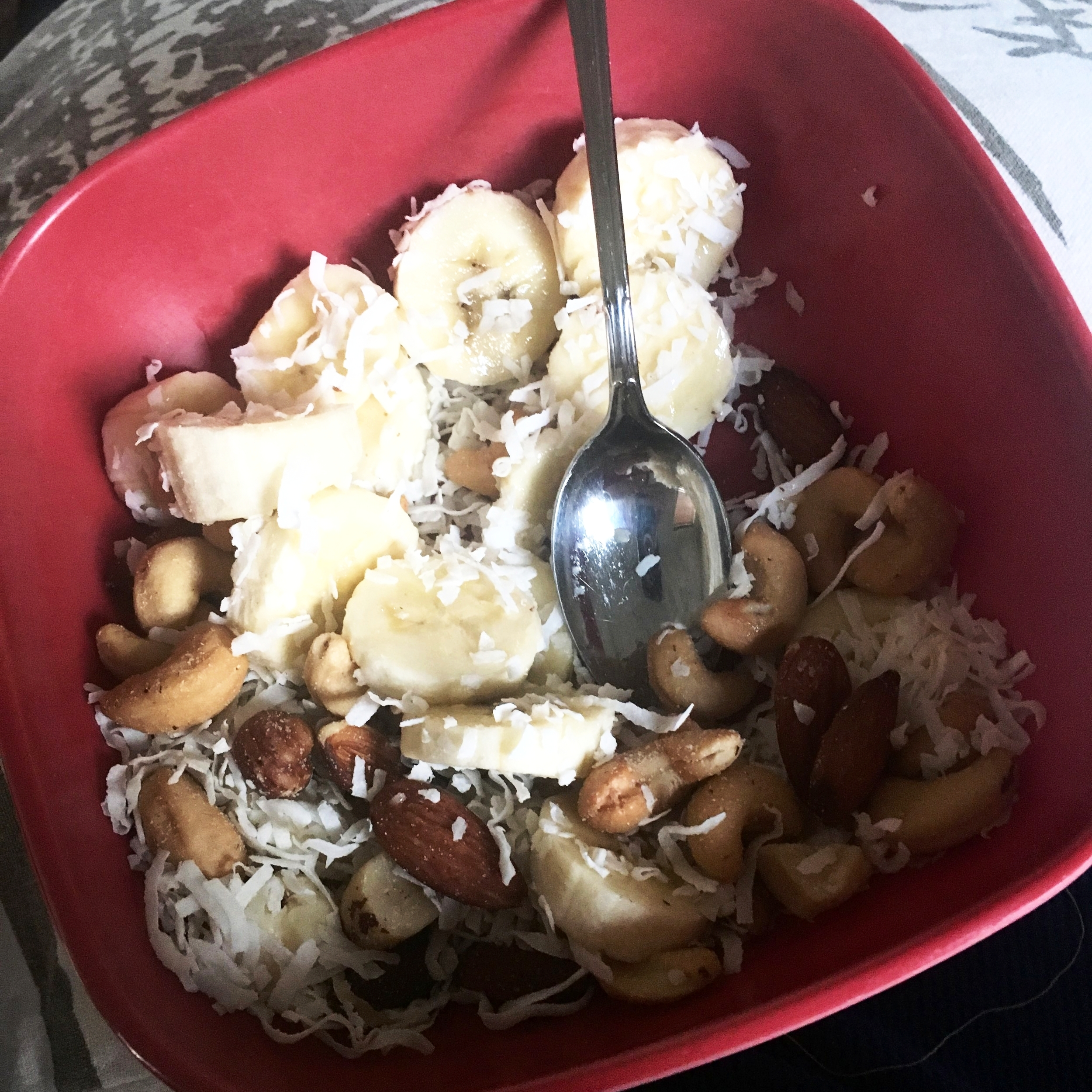1 Banana, 2-3 tbsp shredded unsweetened coconut, palm full of mixed nuts. So good!