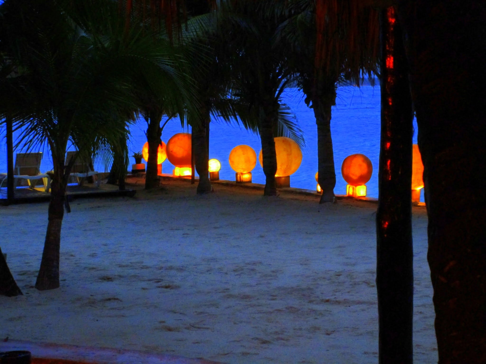 Automatic lights gently come to life as the sun sets over the horizon at the El Dorado Seaside Suites Resort