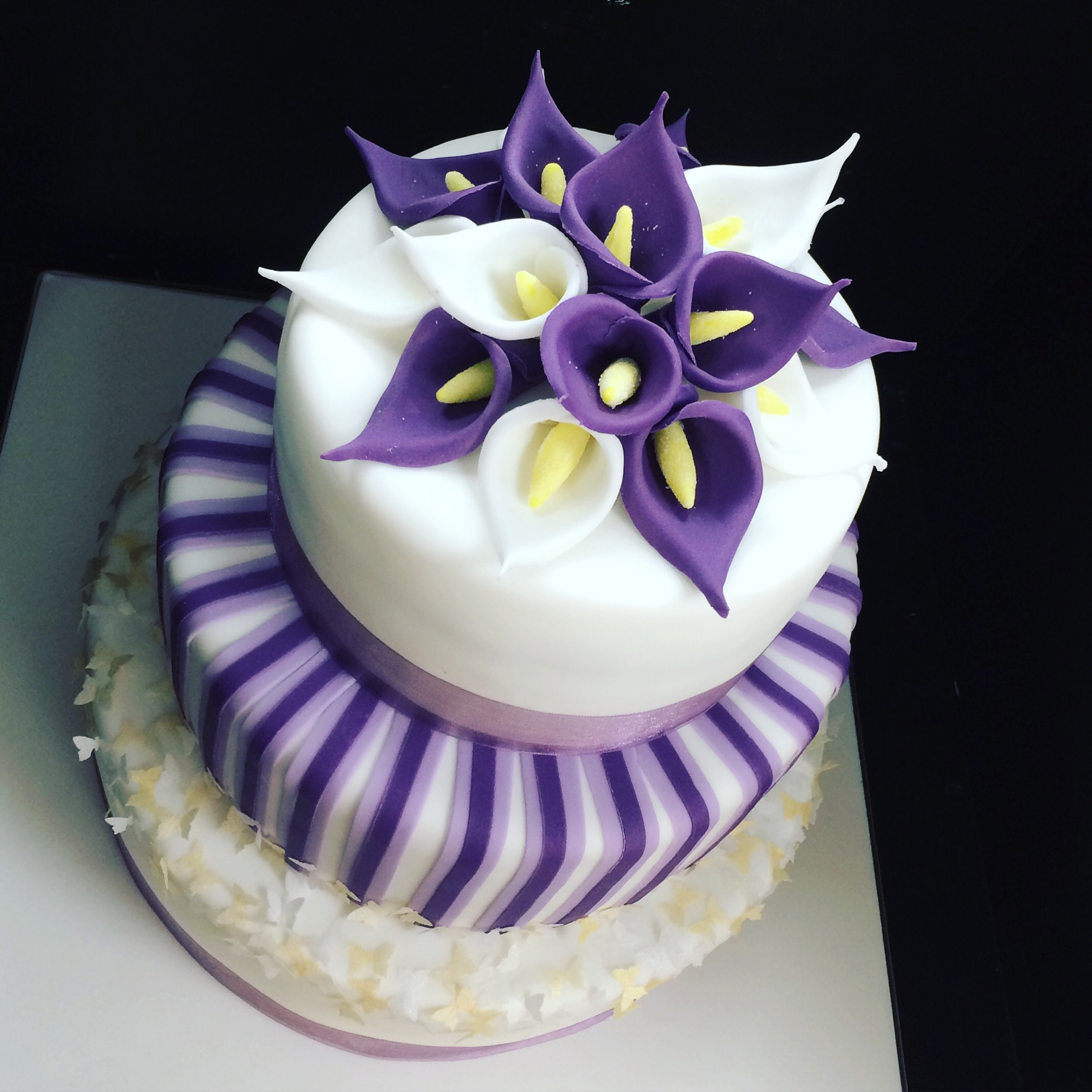 A purple-themed Cala Lilly Birthday Cake with a Kaleidoscope of Gold & Silver Butterflies.