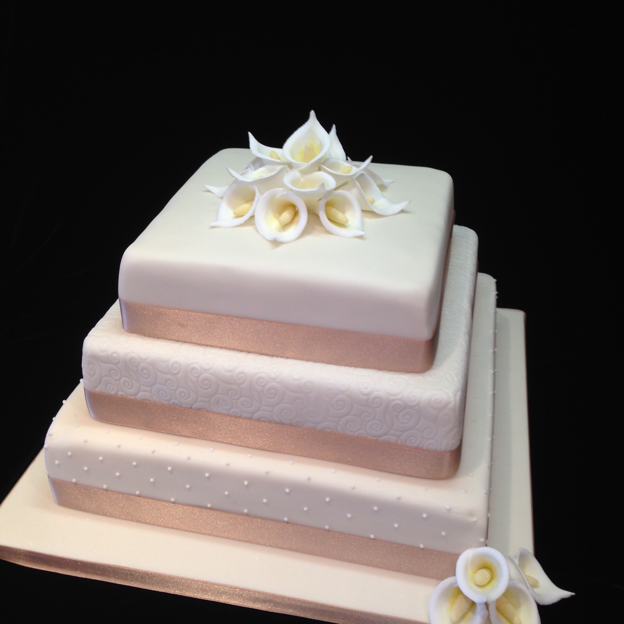 Three tiers of Red Velvet, Carrot & Lemon with a Calla Lily topper