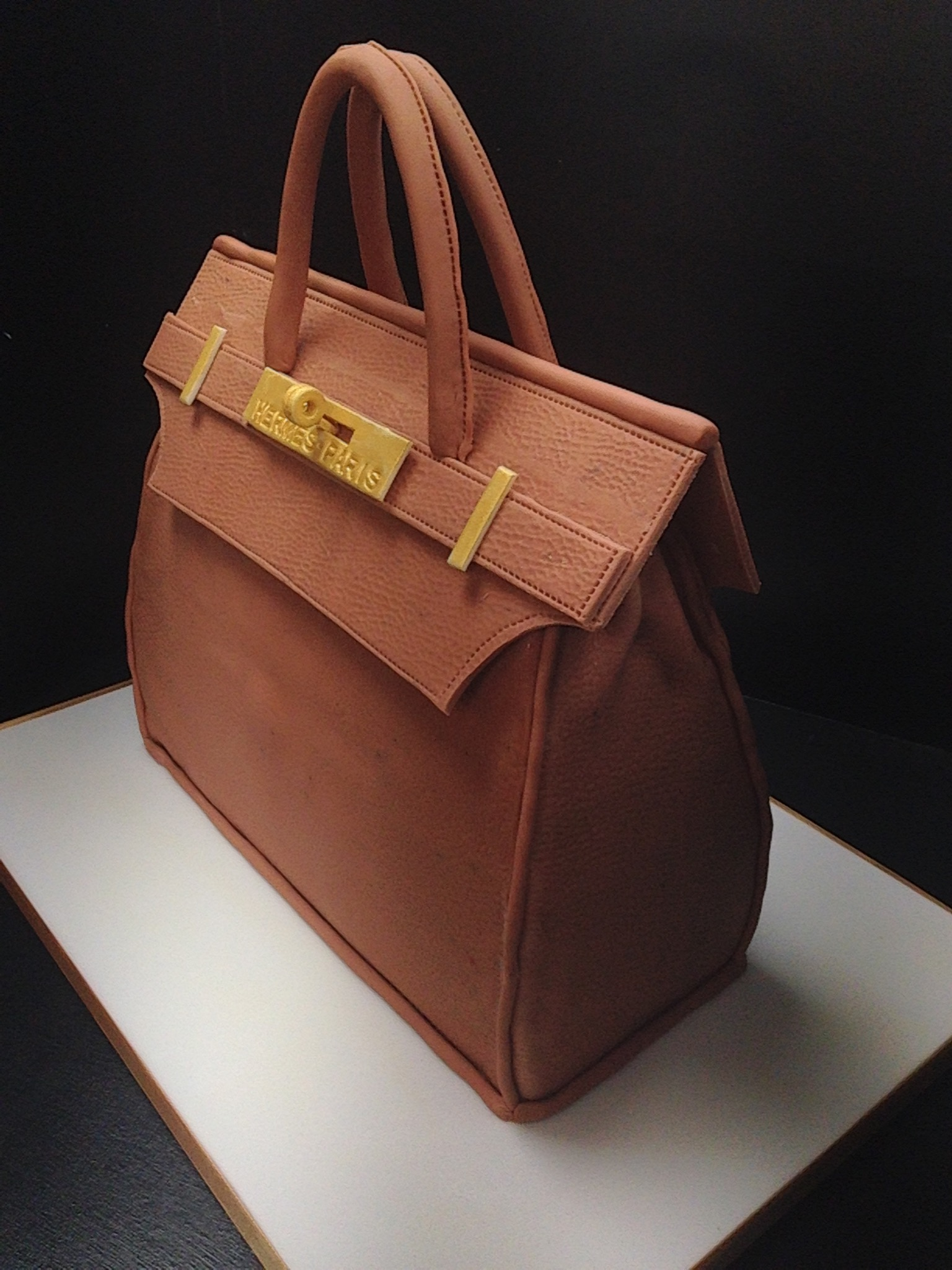 A special 'Hermes' handbag. Chocolate sponge layered with chocolate ganache and buttercream.