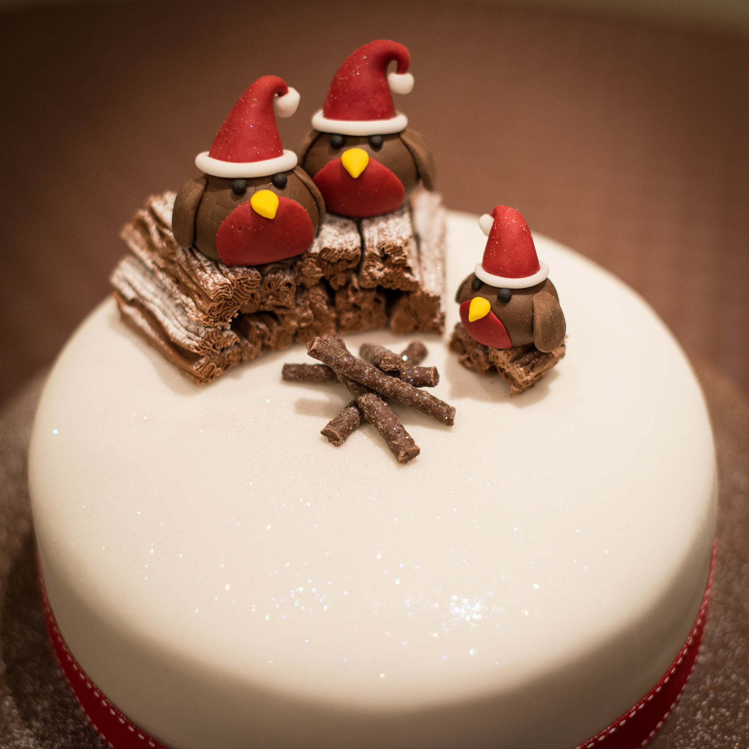 Three Chocolate Robins on a Christmas Fruitcake