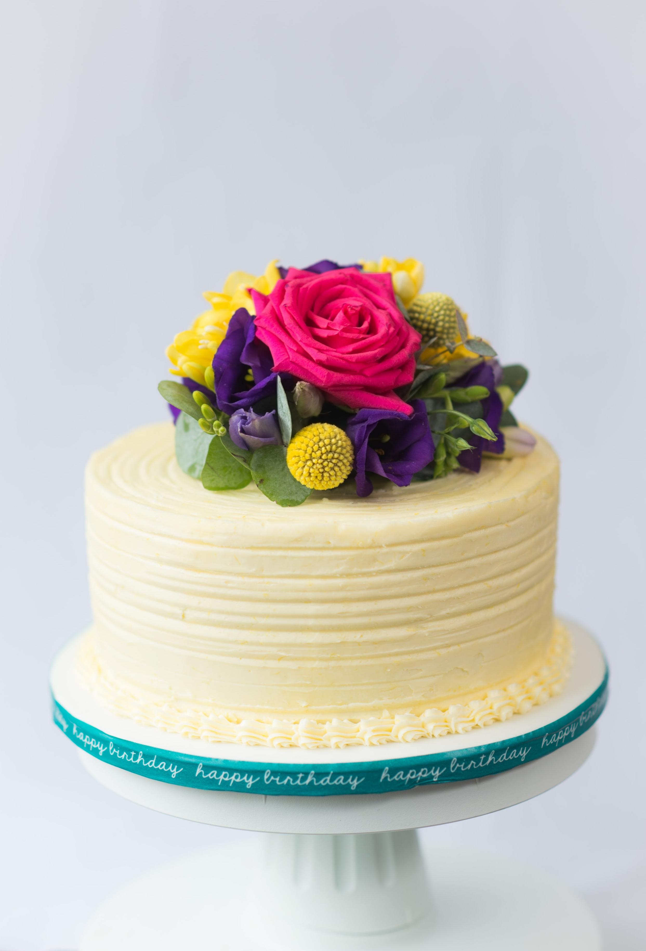 Gluten-free, lemon-iced flower cake.