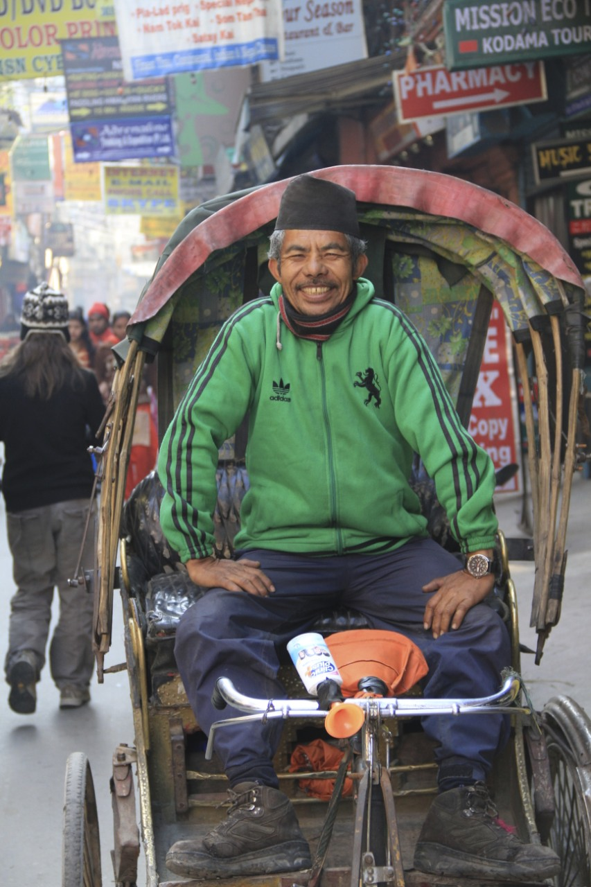 My local rickshaw driver complete with toy squeaking horn - seven years later he is still there ( May 2017 ) looking exactly the same