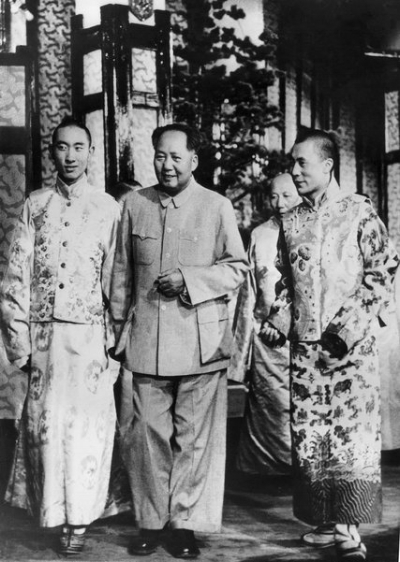The Panchen Lama, left, the Dalai Lama aged 21, right, with Mao Zedong in 1956, the year a failed rebellion broke out in Eastern Tibet.