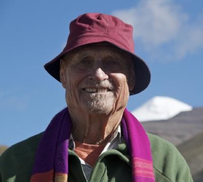 Bebe at 78 has just completed 53 km at 18,500 feet - Mt Kailash behind him