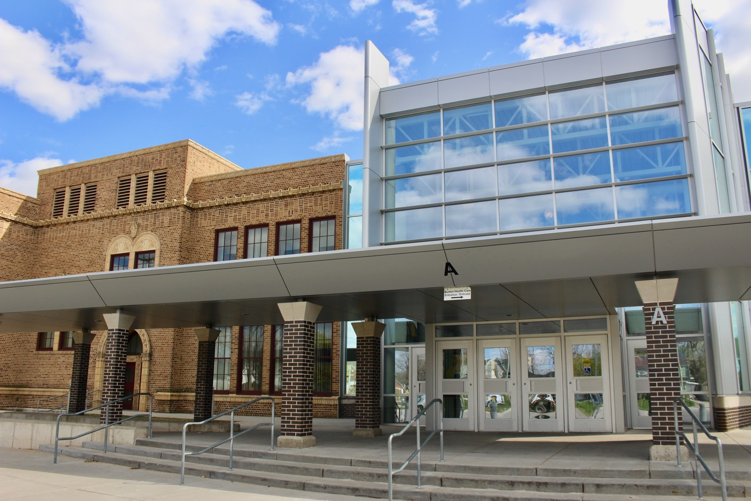 BEAUTIFUL BURTON SCHOOL DESIGNED BY HENRY H. TURNER WITH A NEW MODERN ADDITION THAT IS COMPLEMENTARY TO THE OLD BUILDING.