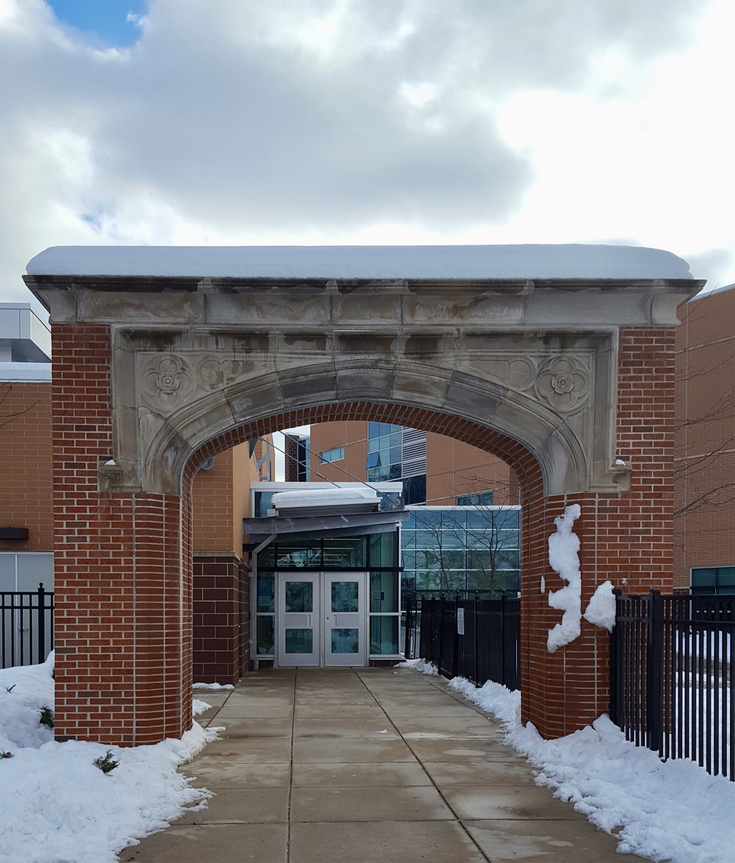 ORIGINAL ARCH IS ALL THAT REMAINS OF THE OLD MODIFIED GOTHIC STYLE . DICKINSON SCHOOL WAS REPLACED BY A NEW BUILDING.