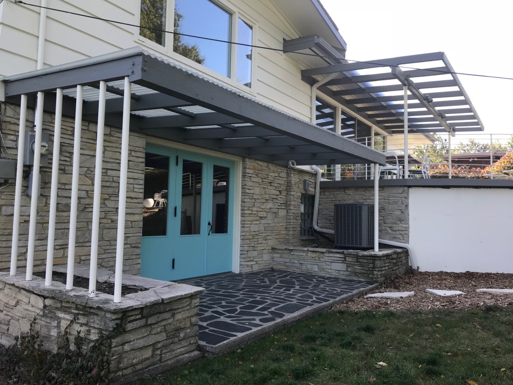 DOORS FROM LOWER LEVEL TO BACKYARD